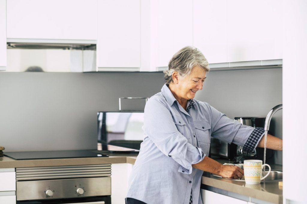 Cheerful old senior caucasian woman at home